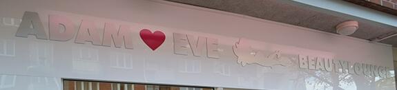 Schriftzug Adam & Eve